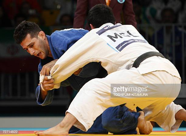 Iranian judoka Arash Miresmaeili fights with Mongolia's Tsagaanbaatar Haskhbaatar during their Asian Games judo men's under 66kg gold medal final...