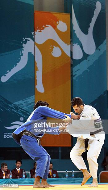 Iranian judoka Arash Miresmaeili fights with Saudi Arabian Adbulrahman Mohammed Al Hazmi during their Asian Games judo men's under 66kg preliminary...