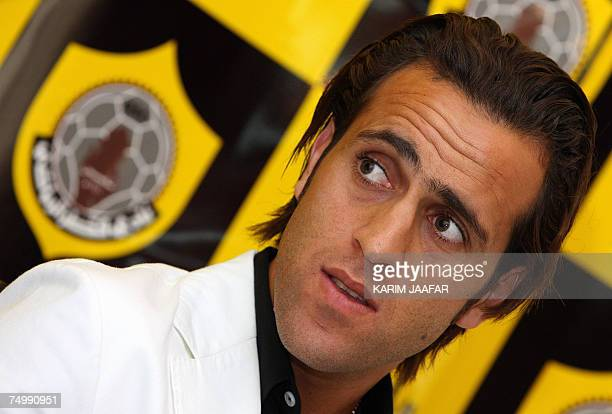 Iranian soccer star Ali Karimi attends a press conference after signing a twoyear contract with Qatar club in Doha 03 July 2007 AFP PHOTO/KARIM JAAFAR
