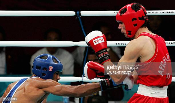 Iraqi Jabar Zuhir throws a low punch to Afghan boxer Mohammad Naim Amini in their super lightwight 64kg preliminary bout during the 15th Asian Games...