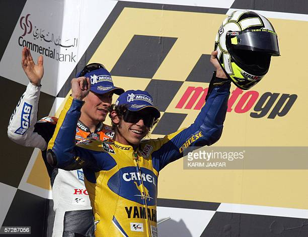 Italian rider and world champion Valentino Rossi celebrates after winning the Qatar MotoGP World Championship 08 April 2006 at the Losail...