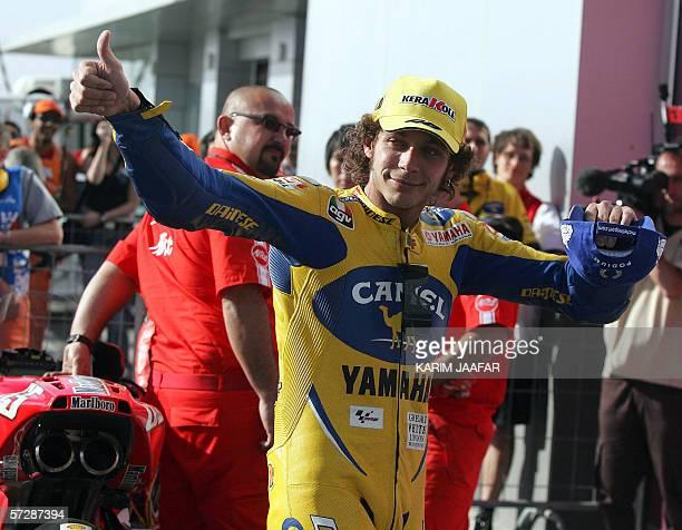 Italian rider and world champion Valentino Rossi celebrates after winning the Qatar Grand Prix World Championship 08 April 2006 at the Losail...