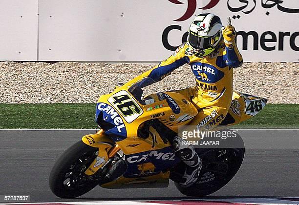 Italian rider and world champion Valentino Rossi of Yamaha jubilates after winning the Qatar Grand Prix World Championship 08 April 2006 at the...
