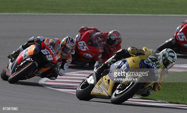 Italian rider and world champion Valentino Rossi of Yamaha leads Nicky Hayden of the USA and Loris Capirossi of Italy during the Qatar Grand Prix...