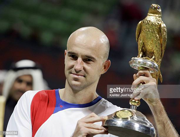 Ivan Ljubicic of Croatia holds a trophy after winning the onemillion dollar Qatar Open tennis final against Scot Andy Murray in Doha 06 January 2006...