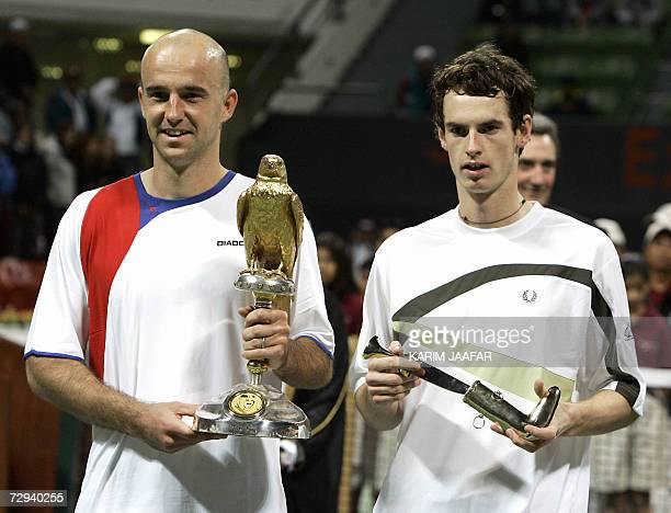 Ivan Ljubicic of Croatia holds his trophy after winning the onemillion dollar Qatar Open tennis final match against Scot Andy Murray in Doha 06...