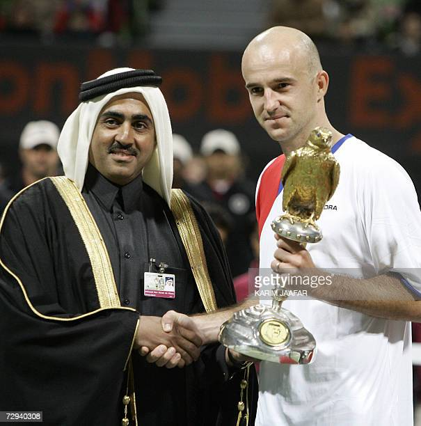Ivan Ljubicic of Croatia receives his trophy from sheikh Mohammed bin Faleh alThani head of the Qatari Tennis Federation during the award ceremony of...