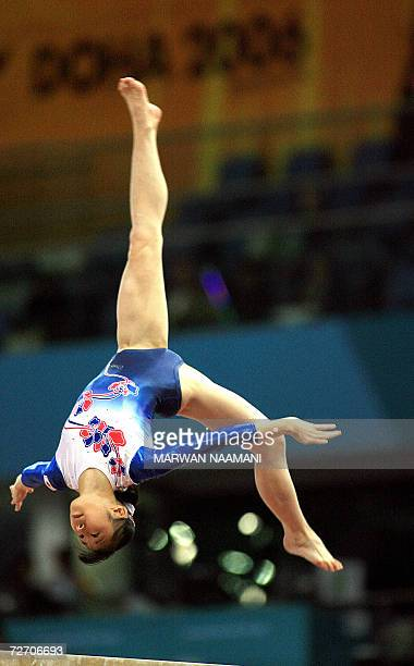Japanese gymnast Miki Uemura performs her beam routine at the Women's Artistic Gymnastics team final 03 December at the Aspire compound at the 15th...