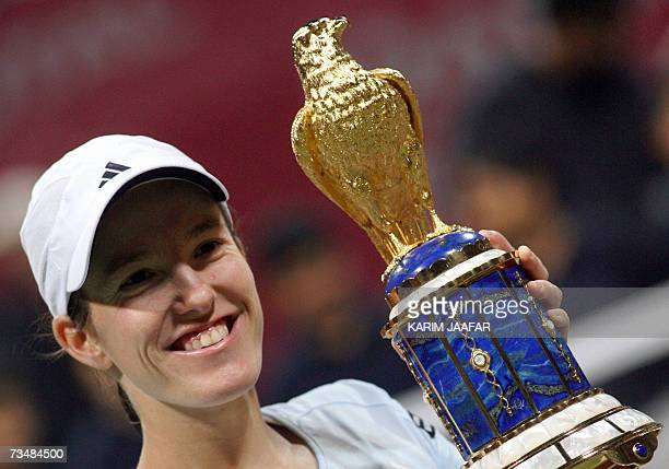 Justine Henin of Belgium poses with her trophy after beating Svetlana Kuznetsova of Russia in their WTA Qatar Total Open final tennis match in Doha...