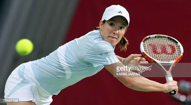Justine Henin of Belgium returns the ball to Alicia Molik of Australia during their tennis match on the third day of the WTA Qatar Total Open in Doha...