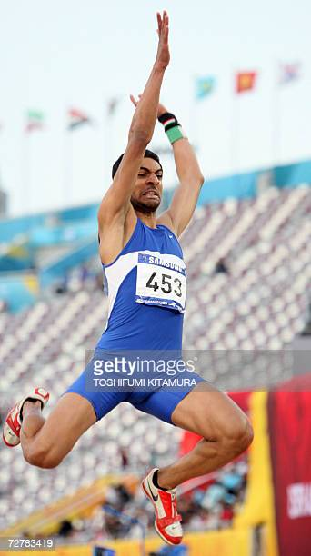 Kuwait's Saleh Al Hadad makes an attempt in the men's long jump final on the second day of the athletics competition for the 15th Asian Games at...