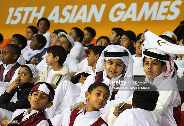 Local schoolchildren attend the day's swimming events at the Hamad Aquatic Centre during the 15th Asian Games in Doha 05 December 2006 With acres of...