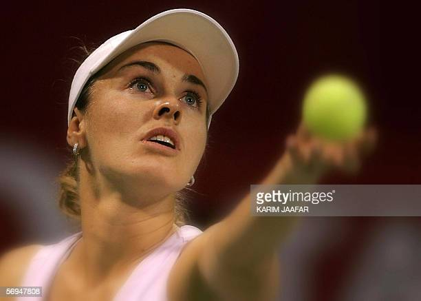 Martina Hingis of Switzerland eyes the ball during her match against Mashona Washington of the US during the first day of the WTA Qatar Total open in...