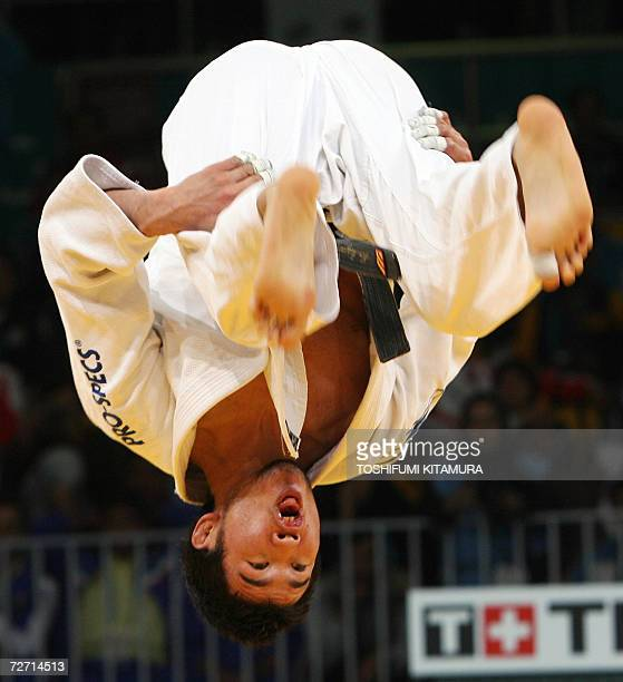 Mongolia's Tsagaanbaatar Haskhbaatar flips in the air after beating Iranian judoka Arash Miresmaeili during their Asian Games judo men's under 66kg...