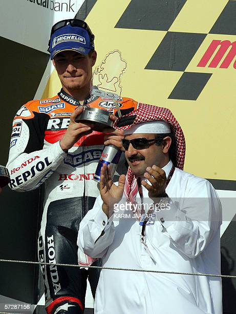 Nicky Hayden of the USA the runner up holds up his trophy as he celebrates his win at the Qatar MotoGP World Championship 08 April 2006 at the Losail...