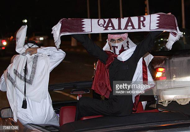 Qatari citizens celebrate in the streets of Doha after the Qatari football team won the gold medal match between Qatar and Iraq at the 15th Asian...