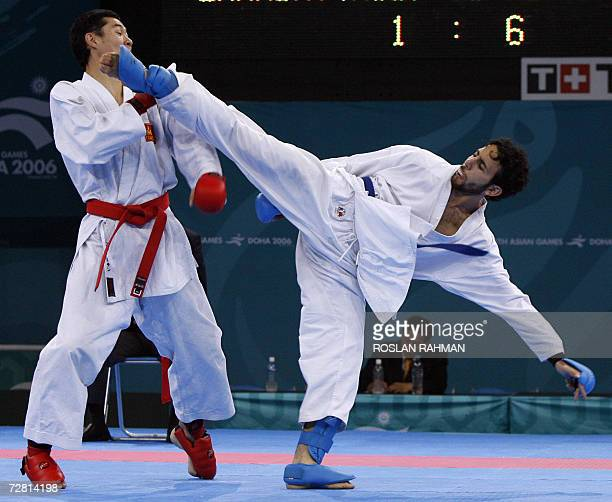 Qatari Magid Adwan fights against Mogolian Enkhj Enkhbat in the men's karate kumite 65kg repechage for bronze during the 15th Asian Games in Doha 13...