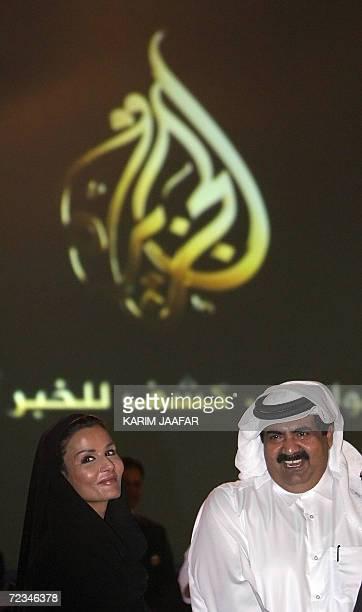 Qatar's Emir Sheikh Hamad bin Khalifa alThani and his wife Sheikha Moza bint Nasser alMisnad attend a ceremony marking the 10th anniversary of...