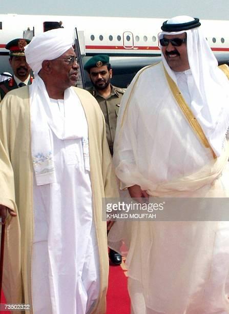 Qatar's Emir Sheikh Hamad bin Khalifa alThani greets Sudanese President Omar alBeshir upon his arrival in Doha 06 March 2007 Sudan is seeking to take...