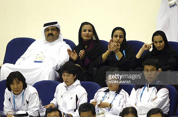 Qatar's Emir Sheikh Hamad Bin Khalifa alThani his wife Sheikha Moza bint Nasser alMissnad and their daughter alMayssah watch the Men's Handball...