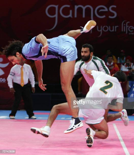 RECROPPED VERSION India' s Manpreet Singh leaps in the air to beat Pakistan's Muhammad Akram and Nasir Ali during the men's kabaddi gold final match...
