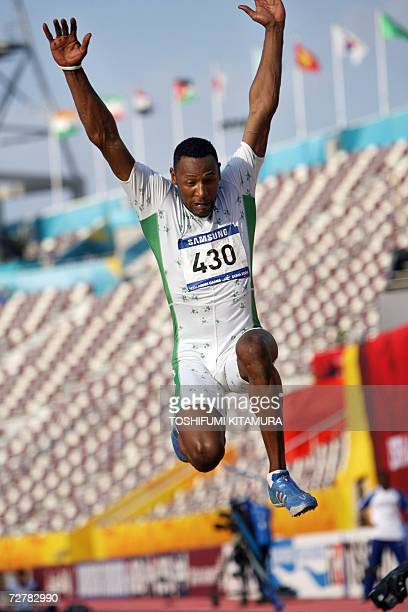 Saudi Arabia's Ahmed Faez Bin Marzouq makes an attempt in the men's long jump final on the second day of the athletics competition for the 15th Asian...