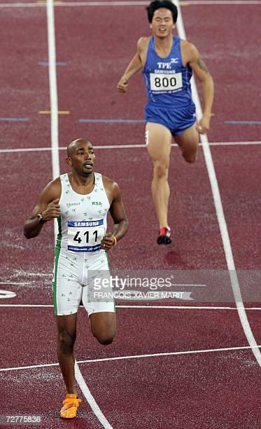 Saudi Arabia's Hamdan Awdah Al Bishi crosses the finish line ahead of Taiwan's Chung Chen Kang in the men's 400m heat 1 on the opening day of the...