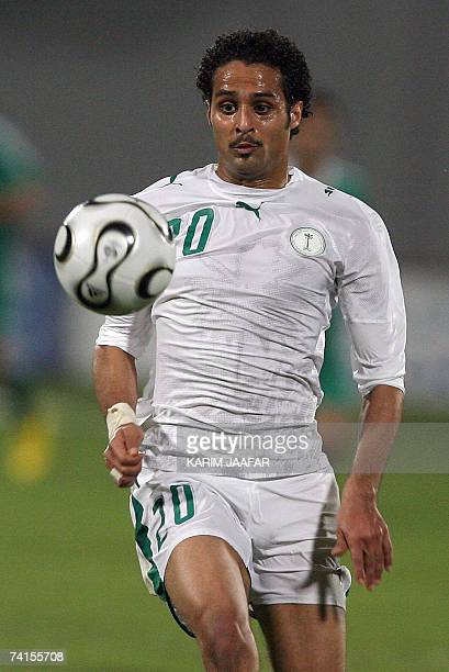 Saudi football team forward Yasser alQahtani is seen in action during the 18th Gulf Cup championship against Iraq in the Emirati capital of Abu Dhabi...