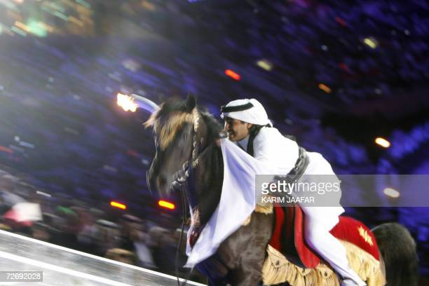 Sheikh Mohammed bin Hamad AlThani captain of the Qatari Endurance Equestrian team rides a horse to the top of Khalifa stadium to light the cauldron...