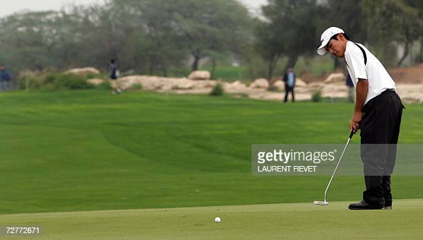 South Korean golfer Kang Sung Hoon putts during the men's individual 1st round at the 15th Asian Games in Doha 08 December 2006 AFP PHOTO/Laurent...