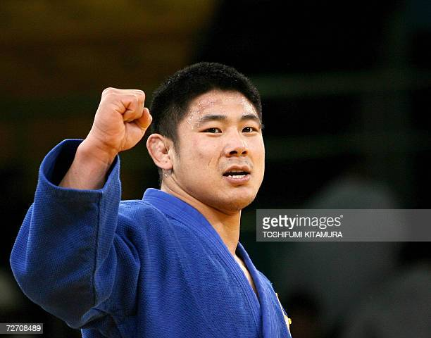 South Korean Hwang HeeTae clinches his fist in jubilation after beating Kazakhstan's Maxim Rakov in the Asian Games men's judo under 90kg gold medal...
