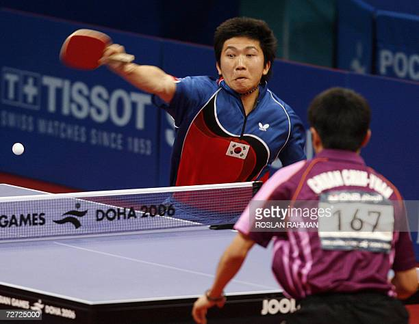 South Korea's Ryu Seung Min compete wit Taiwan's Chuang Chih Yuan in the Men's Single table tennis quarterfinal match at the AlArabi Sports Club...