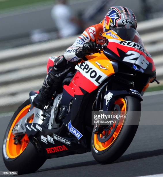 Spanish rider Dani Pedrosa of Honda speeds during a practice session at the Losail International Circuit on the outskirts of the Qatari capital Doha,...