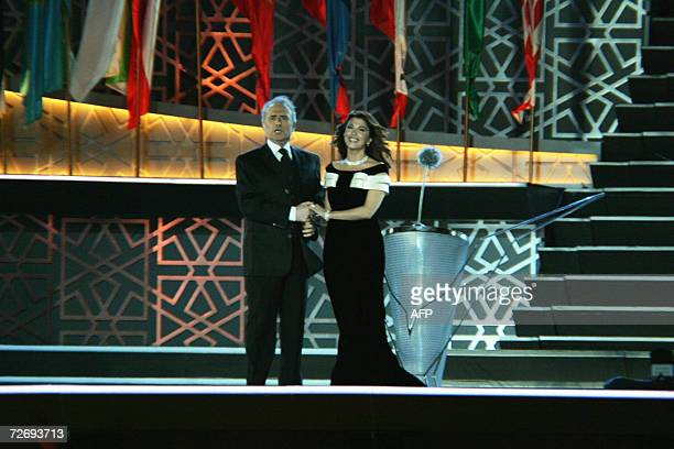 Spanish Tenor Jose Carreras and Lebanese singer Magida al-Roumi perform during the opening ceremony of the 15th Asian Games in Doha, 01 December...