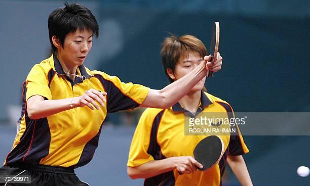 Taiwan's duo Huang Yi Hua and Lu Yun Feng competes with China's Guo Yue and Li Xiaoxia in the Women's Double semi-final match at the Al-Arabi Sports...