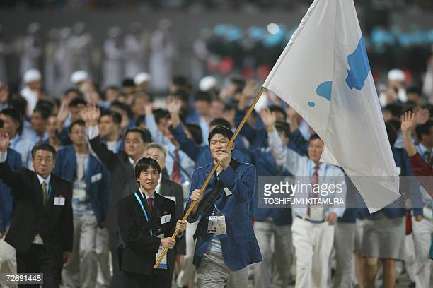 The Korean Unification flag is carried in front of the joint North and South Korean athletic delegation during the 15th Asian Games in Doha 01...