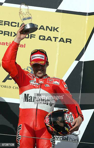 Third place winner Loris Capirossi of Italy holds up his trophy at the Qatar MotoGP World Championship 08 April 2006 at the Losail International...