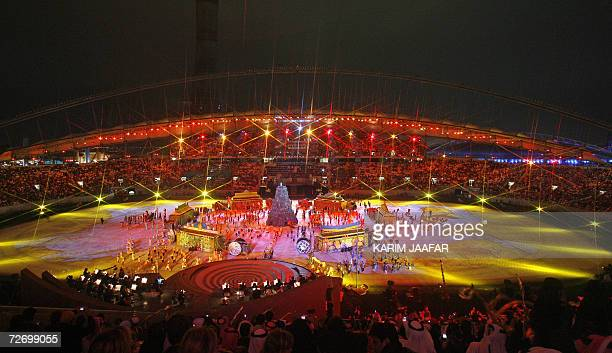 This overview shows performers taking part in the opening ceremony for the 15th Asian Games at Khalifa Stadium in Doha, 01 December 2006. After years...