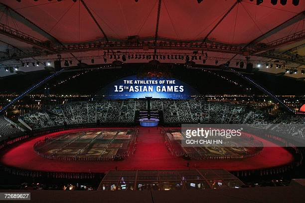 This picture taken 29 November, 2006 shows performers taking part in the rehearsal for the opening ceremony of the 15th Asian Games at Khalifa...