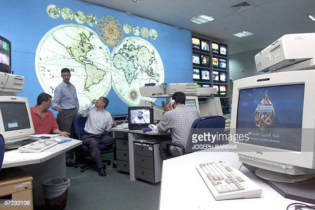 TO GO WITH 'AsiamediatelevisionJazeeraschedFEATURE' This file photo dated 10 October 2001 shows AlJazeera staff working at the satellite channel's...