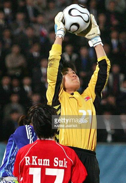 TO GO WITH STORY Asiad2006FblwomenPRKJPN North Korean goalkeeper Jon Myong Hui reaches up for a save against Japan in the women's gold medal football...