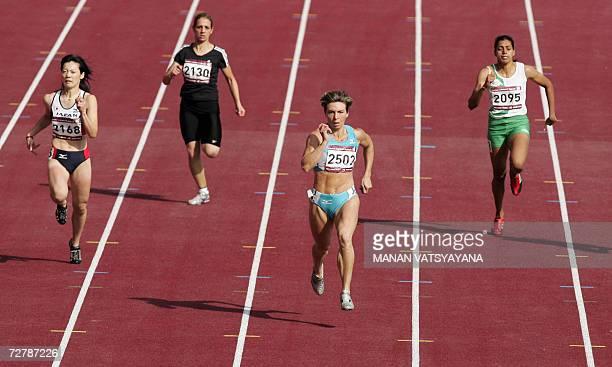 Uzbekistan's Guzel Khubbieva crosses the finish line ahead of Japan's Sakie Nobuoka Abdul Razak Dana and India's Chitra Kulathummuriyil in the...