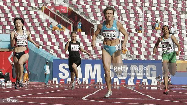 Uzbekistan's Guzel Khubbieva sprints ahead of Japan's Sakie Nobuoka Iraq's Abdul Razak Dana and India's Chitra Kulathummuriyil in the women's 200m...