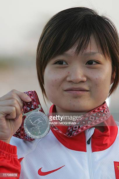 Women's 10m Air Pistol silver winner Guo Wenjun poses with her medal at the 15th Asian Games at the Lusail Shooting Centre in Doha 03 December 2006...