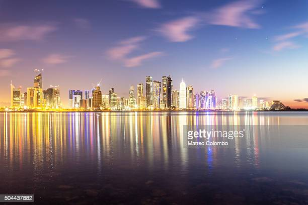 Doha skyline and harbor at dusk, Qatar, Middle East