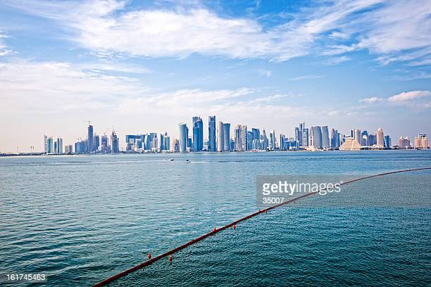 doha skyline - doha stock photos and pictures