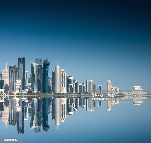 doha skyline reflections - doha stock pictures, royalty-free photos & images