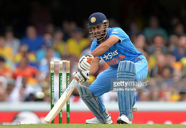 S Dohni of India plays a shot during game two of the Victoria Bitter One Day International Series between Australia and India at The Gabba on January...