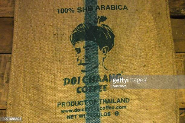 Doi Chaang Coffee logo seen on a bag in a coffee shop in Chiang Rai The Doi Chaang brand has been rated in the top 1% of coffees worldwide by the...