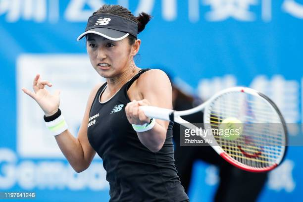 Doi Misaki of Japan returns a shot during the women's singles 1st round match against Kateryna Bondarenko of Ukraine on day 1 of the 2020 WTA...
